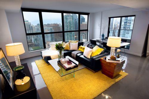 黄色现代风格大气时尚客厅皮沙发装修图