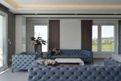 轻奢现代风格客厅蓝色沙发装修图片
