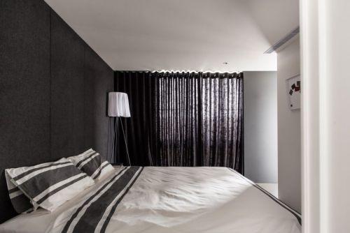 现代风格硬朗大气卧室装修效果图