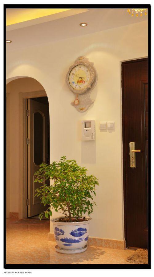 现代简约三居室玄关背景墙装修效果图欣赏