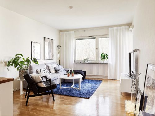 白色自然简约风格客厅装潢装修案例