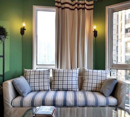 蓝色清新美式客厅沙发装潢图